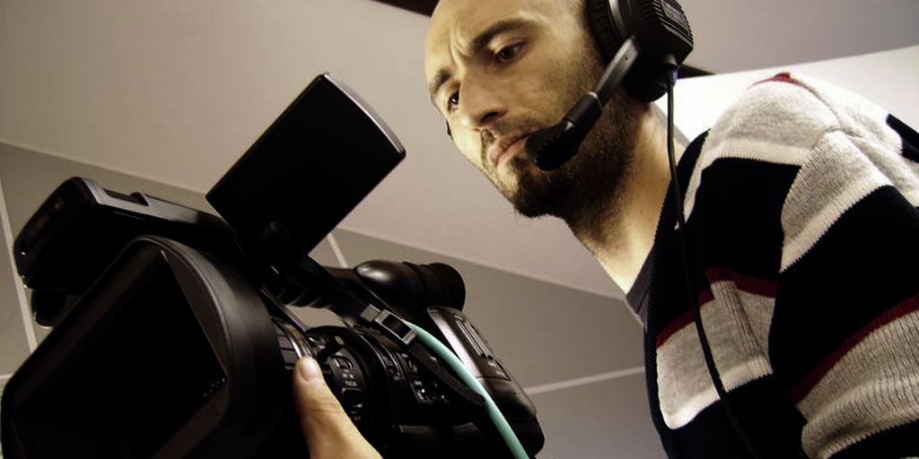 Cameraman, video capture production Licenced from 123RF